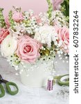 bouquet of flowers and florist... | Shutterstock . vector #607832264