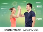 Small photo of sport, fitness, gesture, technology and people concept - smiling man and woman making high give over green background