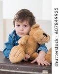 little boy sitting on the... | Shutterstock . vector #607849925