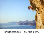young female rock climber... | Shutterstock . vector #607851497