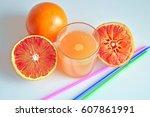 freshly squeezed blood orange | Shutterstock . vector #607861991
