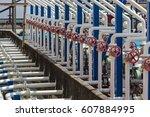 valve plug an oil pipeline in... | Shutterstock . vector #607884995