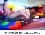 dj mixing in nightclub at party. | Shutterstock . vector #607923977