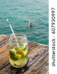 mojito coctail on a wooden... | Shutterstock . vector #607930997