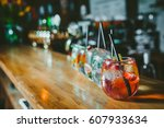 alcoholic cocktail row on bar... | Shutterstock . vector #607933634
