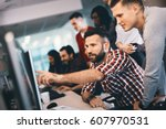 programmer working in a... | Shutterstock . vector #607970531