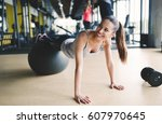 athletic woman during aerobics... | Shutterstock . vector #607970645