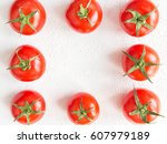 fresh tomato juicy on a branch... | Shutterstock . vector #607979189