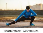 young man warms the muscles of... | Shutterstock . vector #607988021