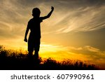 Silhouette Of Kid And The...