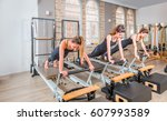 young women exercising on... | Shutterstock . vector #607993589