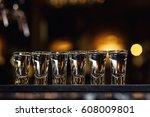 barman pouring hard spirit into ... | Shutterstock . vector #608009801