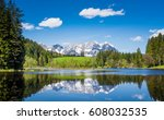 snowy mountain range reflect in ... | Shutterstock . vector #608032535
