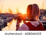 young pretty girl is taking a... | Shutterstock . vector #608066435