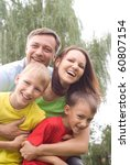 happy boys with family in the...   Shutterstock . vector #60807154