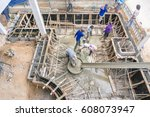 Swimming pool construction. Workers were pouring concrete work.construction work. - stock photo