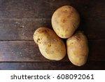 Potato On The Wooden Backgroun...