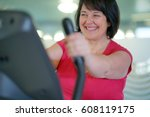overweight woman at the gym...   Shutterstock . vector #608119175