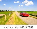red sport car on summer rural... | Shutterstock . vector #608142131