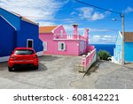 red car at colorful houses scene | Shutterstock . vector #608142221