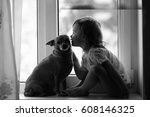 the girl at the window with the ... | Shutterstock . vector #608146325