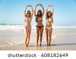 beautiful girls in the beach... | Shutterstock . vector #608182649