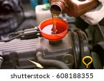 mechanic changing oil in a car   Shutterstock . vector #608188355