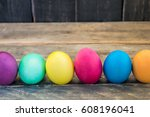 easter eggs on a wooden table . | Shutterstock . vector #608196041