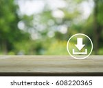 Download Icon On Wooden Table...