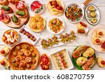 tapas mix and pinchos food from ... | Shutterstock . vector #608270759