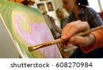 female artist draws a pencil... | Shutterstock . vector #608270984