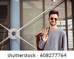 stylish young indian hipster  | Shutterstock . vector #608277764