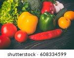 vegetables on a black wooden...