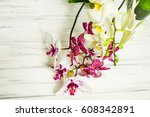 beautiful flowers on a wooden... | Shutterstock . vector #608342891