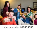 happy friends taking selfie... | Shutterstock . vector #608355335