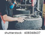 wheel changer   Shutterstock . vector #608368637