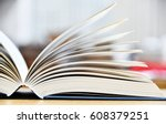 hardcover book lying on the... | Shutterstock . vector #608379251