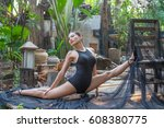 Small photo of woman meditates while practicing yoga in the wood garden. she Freedom concept. Calmness and relax, woman happiness (Seated Wide Legged Straddle)
