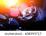Cleaning disc brake on car, in process of new tire replacement. Car brake repairing in garage - stock photo