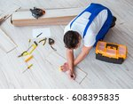 repairman laying laminate... | Shutterstock . vector #608395835