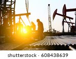 the oil workers at work | Shutterstock . vector #608438639