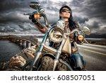biker girl in a leather jacket...   Shutterstock . vector #608507051