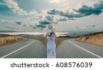 woman standing in front of two... | Shutterstock . vector #608576039