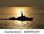 Sea Sunset And Silhouette Of...