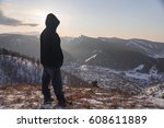 person stand back in mountains | Shutterstock . vector #608611889