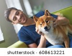 Stock photo close up portrait of shiba inu dog face sitting on green sofa with owner best friend concept 608613221