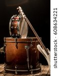 Small photo of musical instruments, drum bass, bass guitar on a black background, the music concept