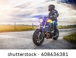 motorbike on the road riding.... | Shutterstock . vector #608636381