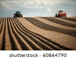 Image Of Two Tractors Planting...