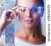 woman in futuristic glasses... | Shutterstock . vector #608656529